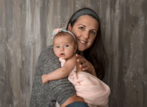 Your Central Virginia newborn baby photographer & family photographer holding baby,